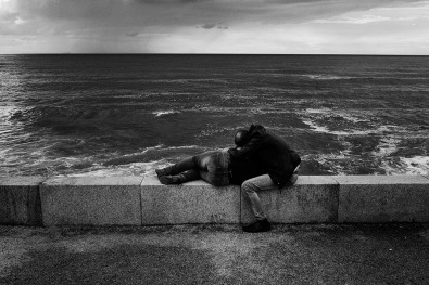 Couple staring at the sea.